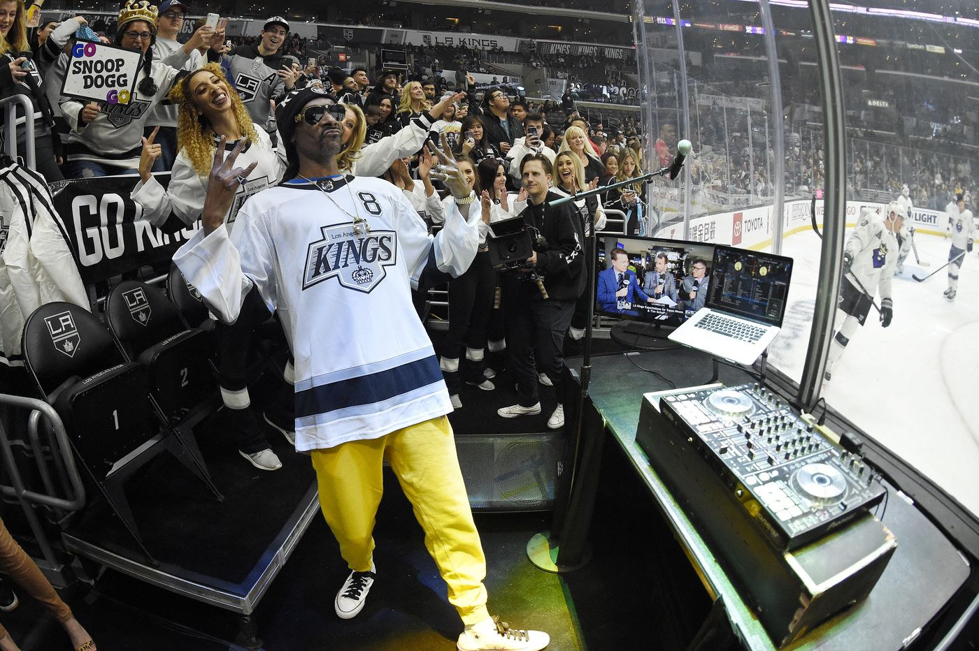 Rapper Snoop Dogg DJ's prior to an NHL hockey game between the Los Angeles Kings and the Colorado Avalanche Saturday, Feb. 22, 2020, in Los Angeles. (AP Photo/Mark J. Terrill)