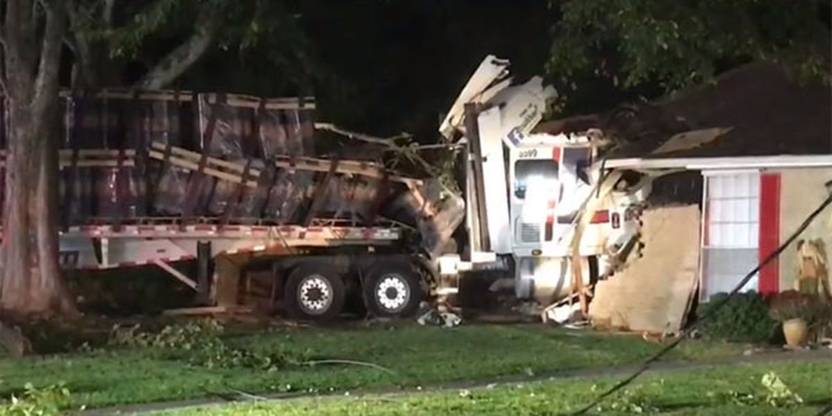Driver taken to hospital after 18-wheeler crashes into house