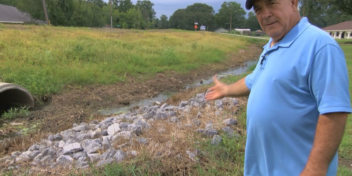 Neighbors blame company with history of delayed projects for new drainage issues