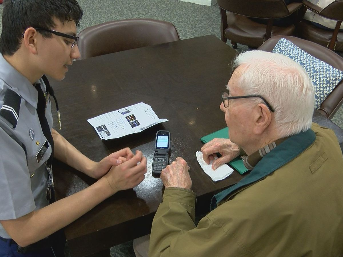 JROTC cadets teach seniors how to use their cell phones