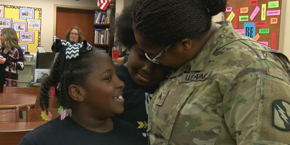 Army mom surprises her two daughters after more than a year away from home