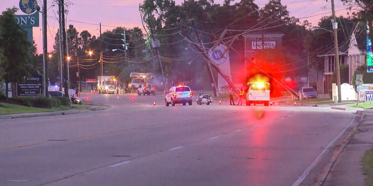 Power being restored to thousands after car strikes pole