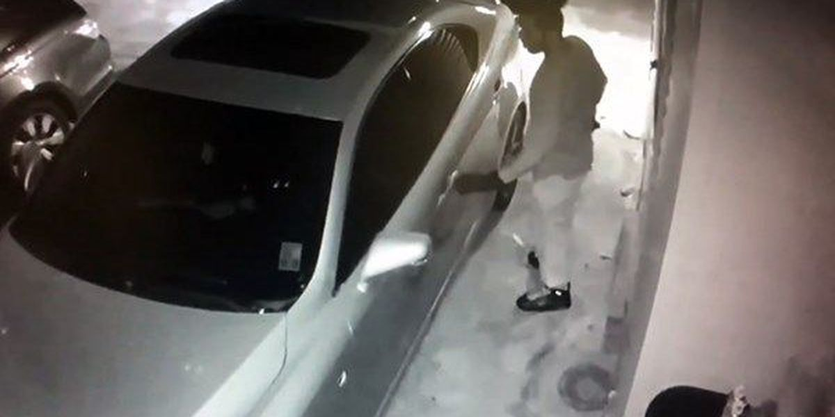 WANTED: Man seen in surveillance footage checking door handles of cars