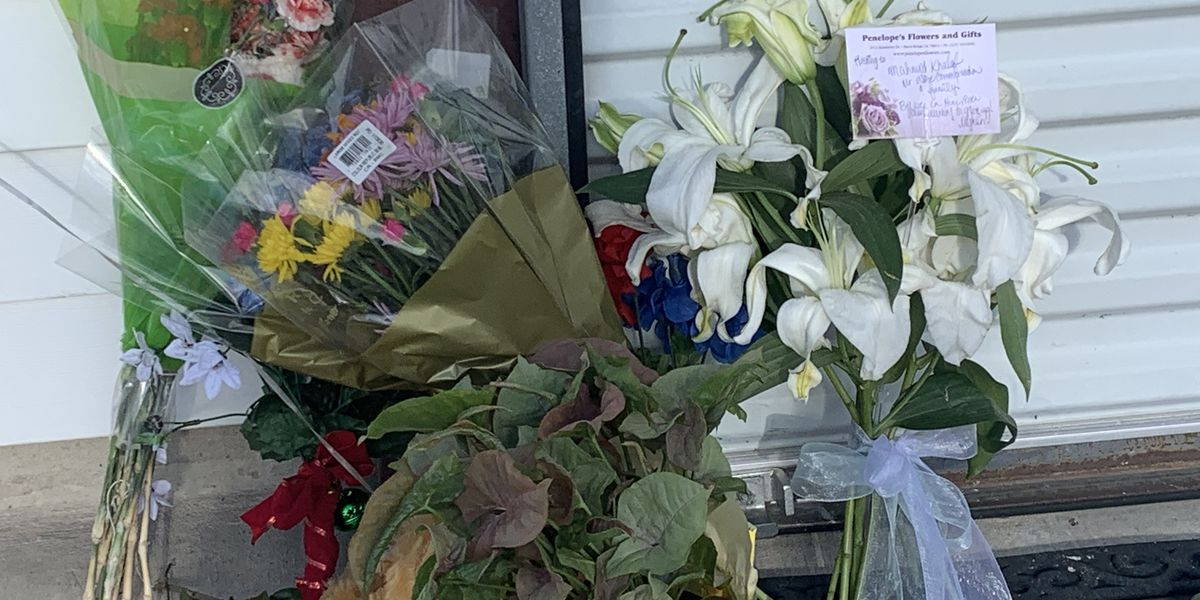 Residents leave flowers, cards in front of Wise Communications after double shooting on Sherwood Blvd