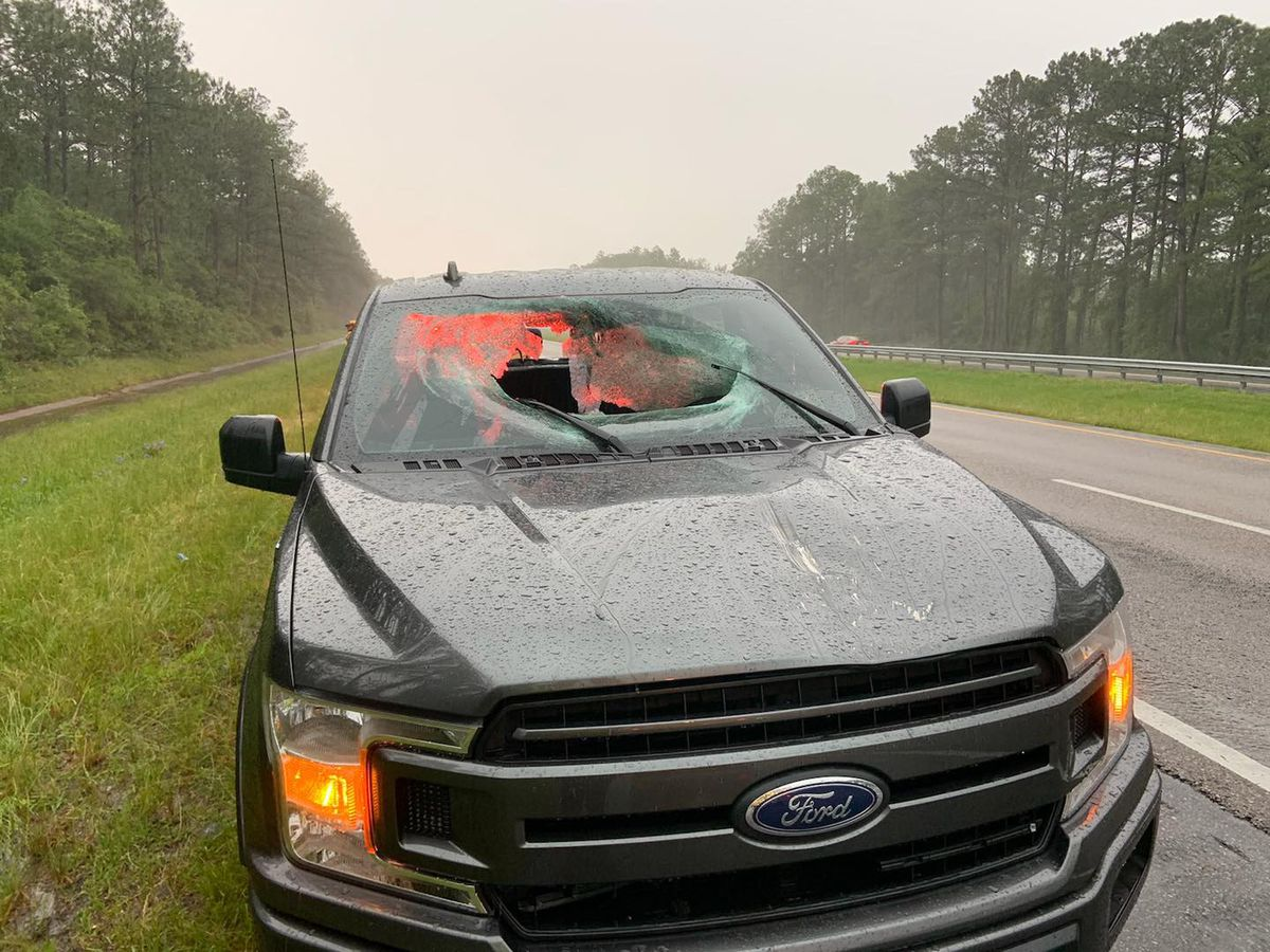 Lightning sends chunk of I-10 pavement through truck's windshield in Florida