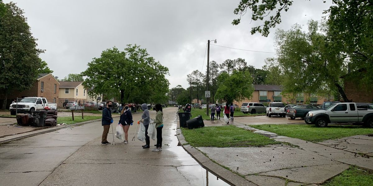 Volunteers work to clean Gardere Streets in the rain a part of EBR's Safe Hopeful Neighborhood Clean Up Operation