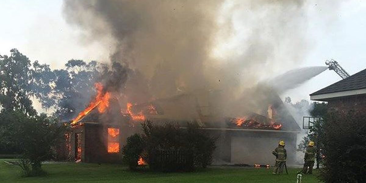 Huge flames consume Gonzales home after possible lightning strike