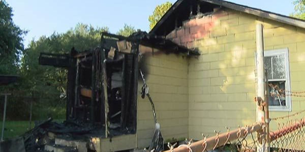 Firefighters say woman jumped out window to escape house fire