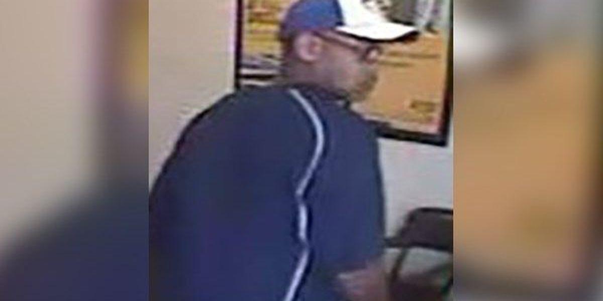 WANTED: Man robs payday loan business at gunpoint