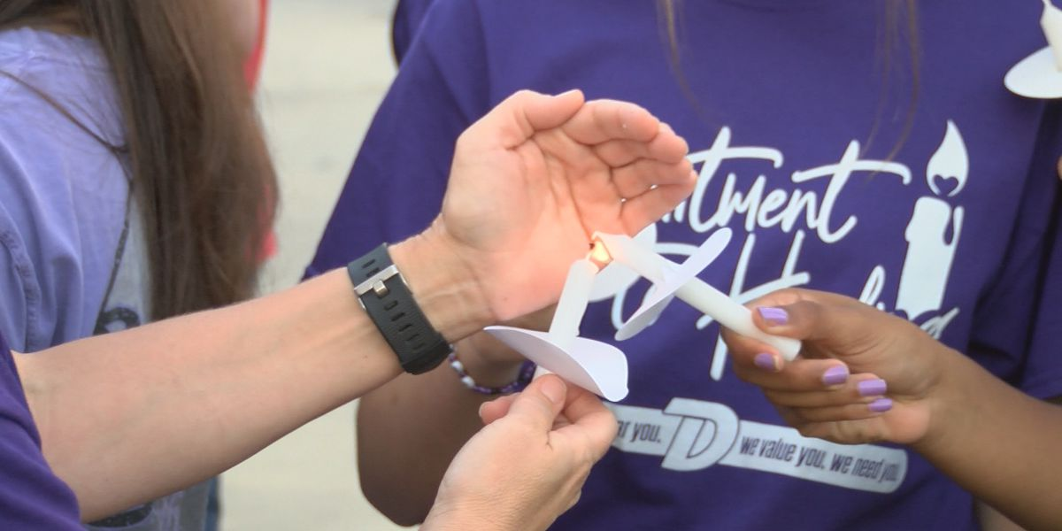 Dutchtown High students hold vigil to raise awareness about teen suicide rates