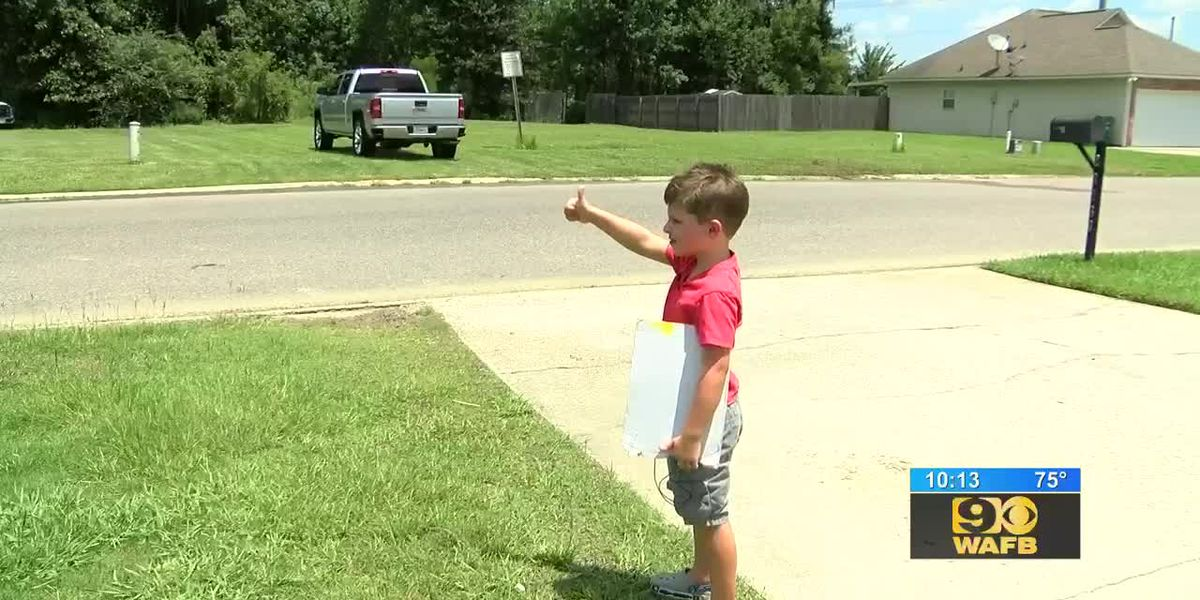 Young boy using kindness to encourage drivers to slow down