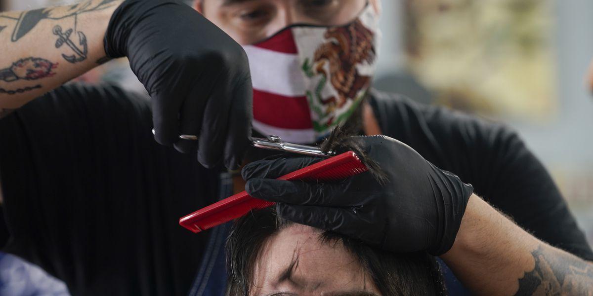 US virus deaths top 100,000, 41 million unemployed