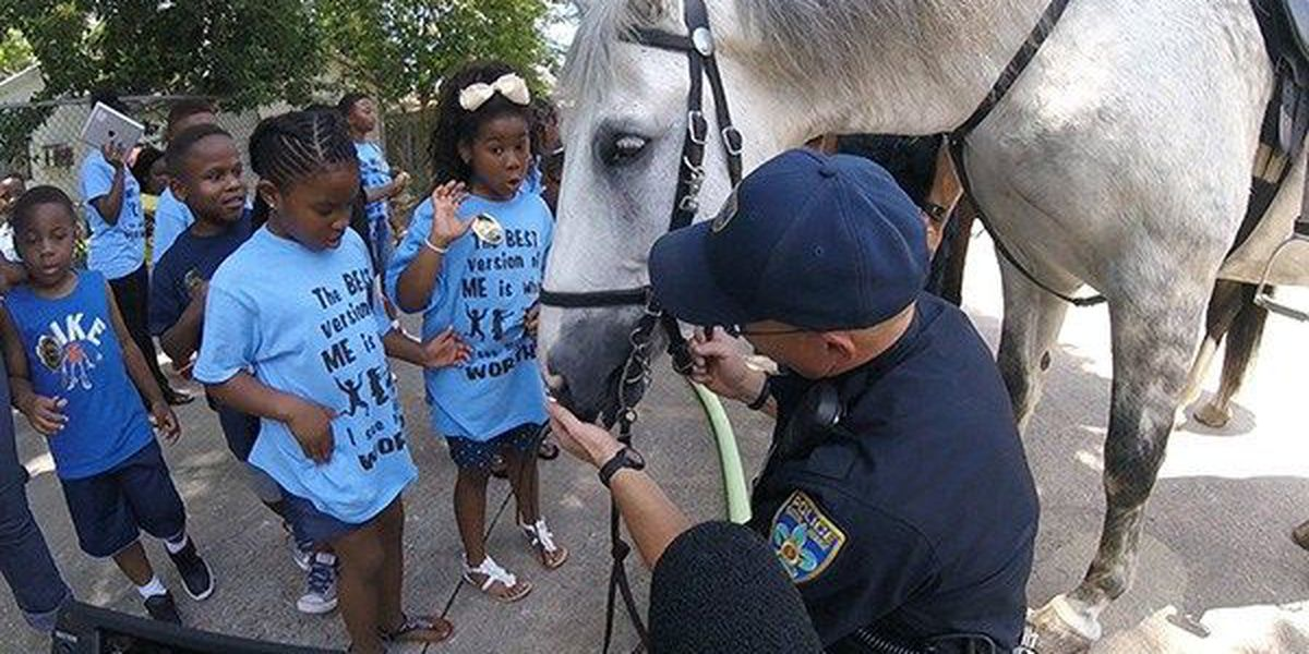 Kids hang out with BRPD officers at Cops Care Summer Camp