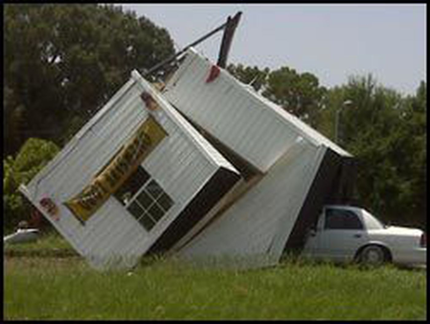 House getting moved flips off trailer and lands on car on recreational land, colonial land, island land, mobile homes sales lot, kansas home land, comet land, industrial land,