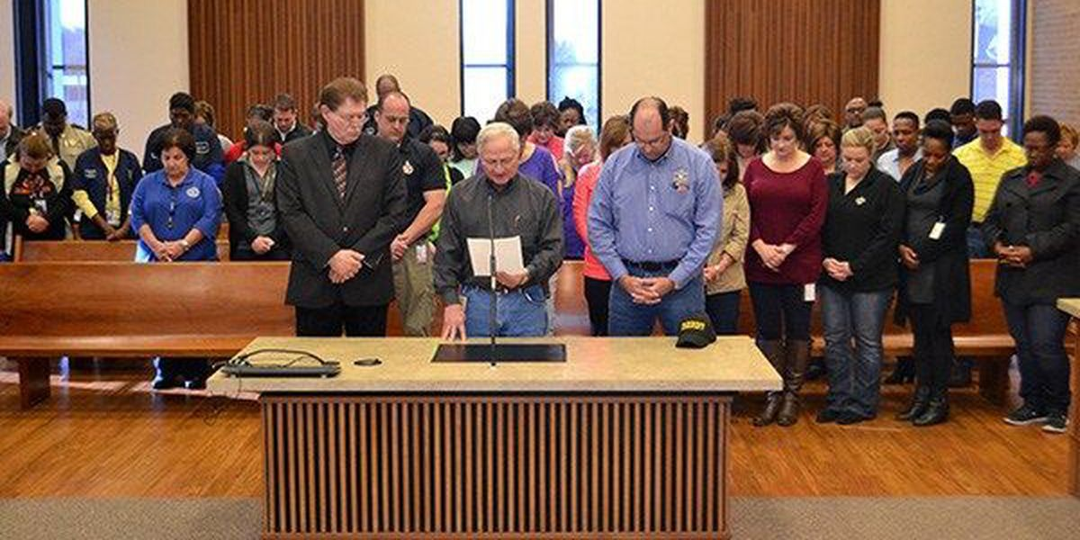 St. James Parish workers observe moment of silence