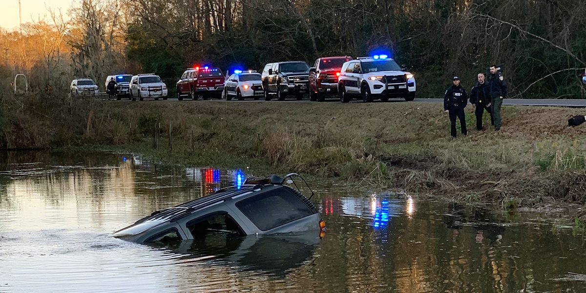 Body recovered from SUV submerged in pond identified as wife of missing Zachary man