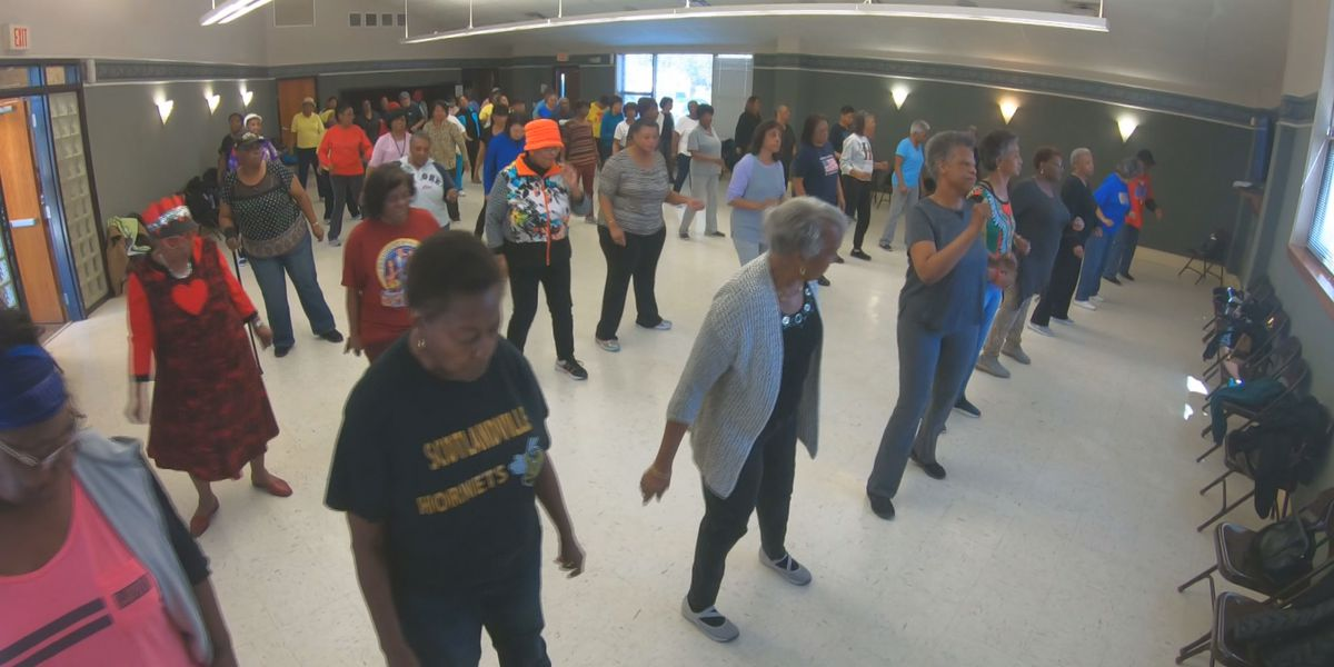 HAND IT ON: Rose Anderson's line dancing class