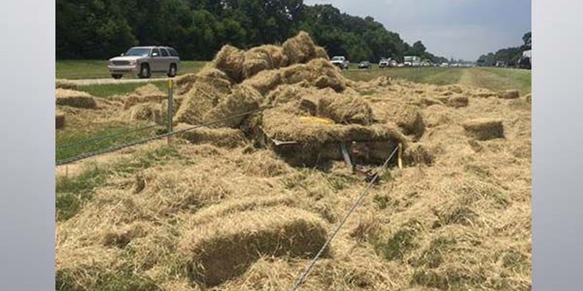 I-10 Eastbound crash at Highland causes delays, trailer loses hay in median