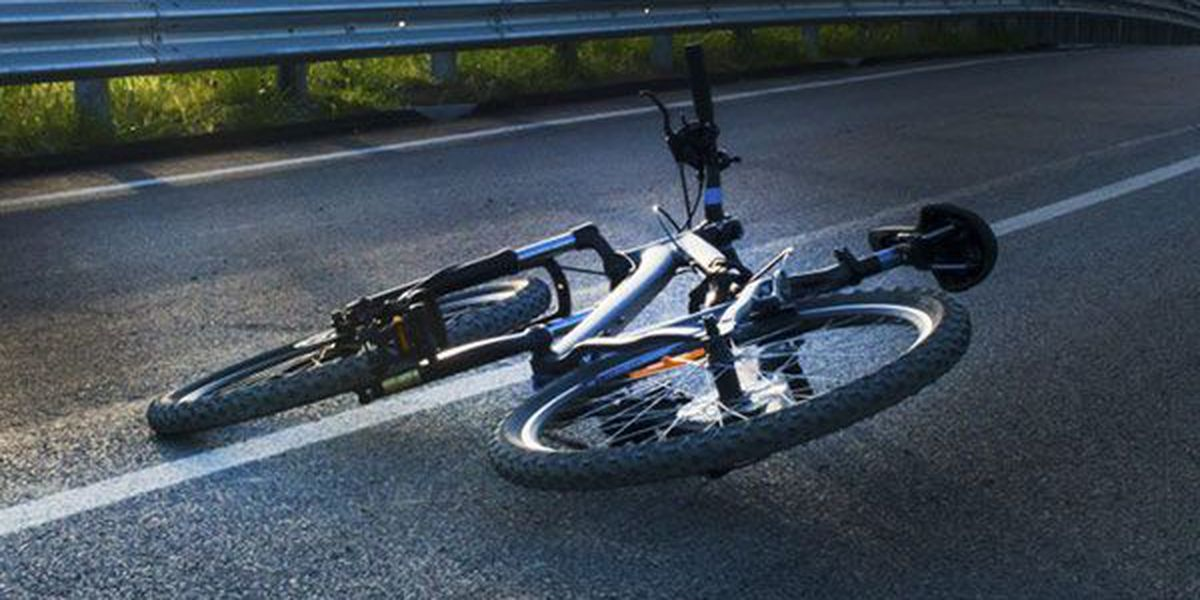 Cyclist dies after being struck by two vehicles in attempt to cross road