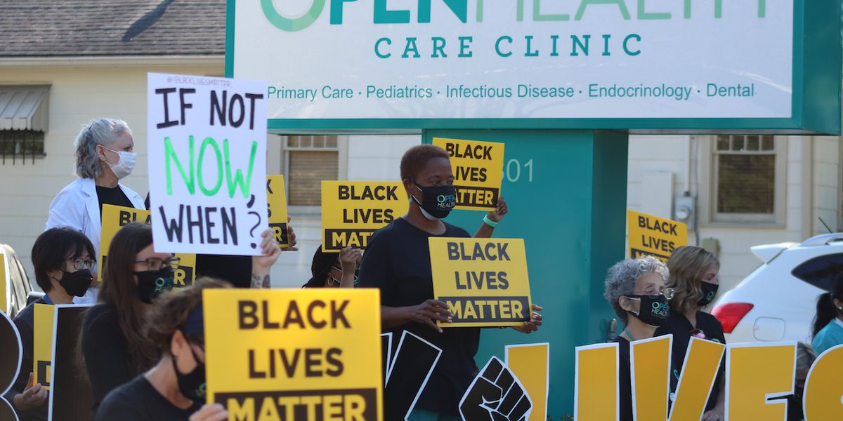 Open Health Care Clinic employees kneel for peace, racial justice