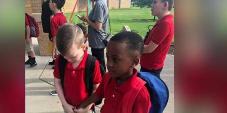 Kansas boy holds hands, calms classmate with autism on first day of school