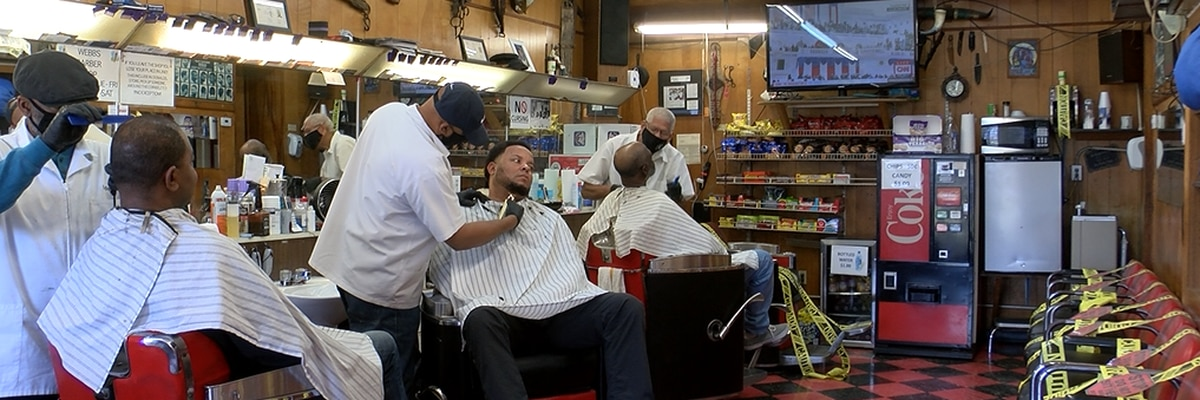 Barber shop normally filled with chatter is quiet as all eyes focus on historic inauguration of Biden, Harris