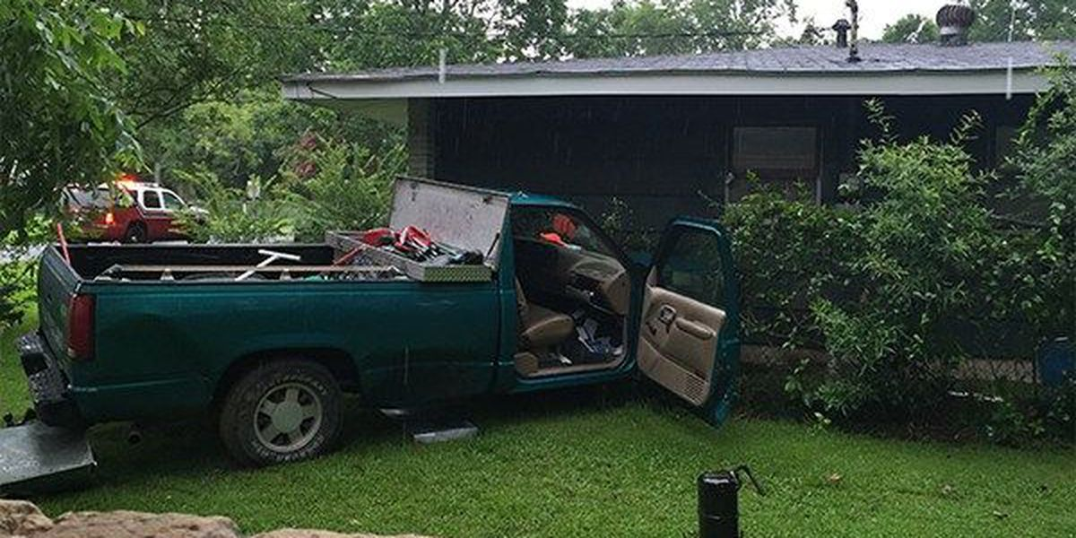 1 person taken to hospital after truck hits front of house