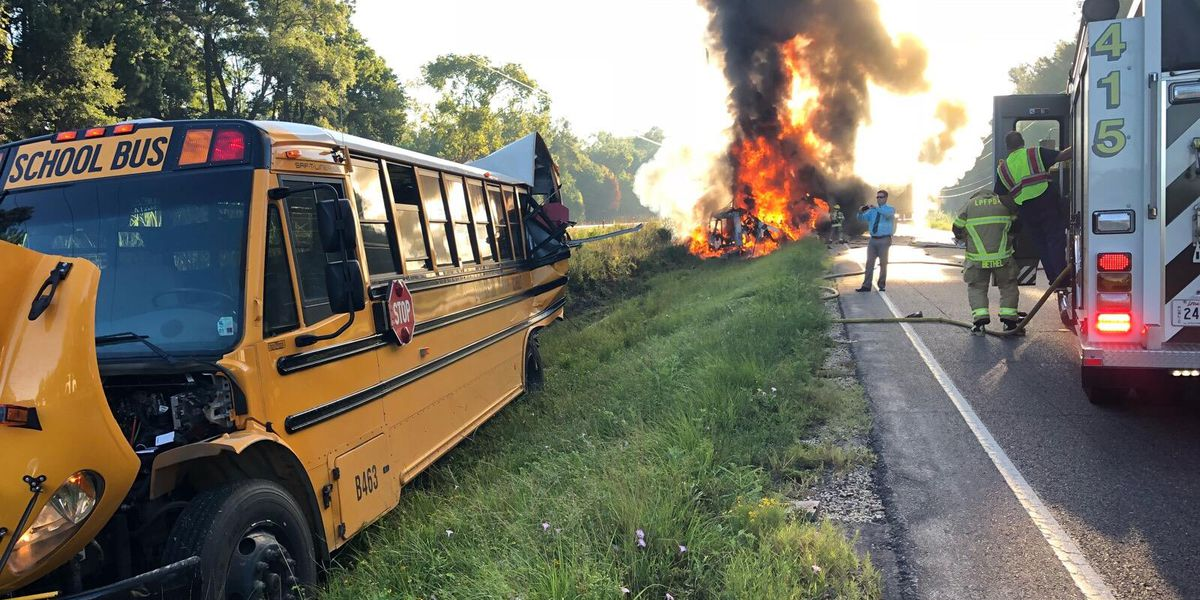 Child taken to hospital after crash involving school bus and truck