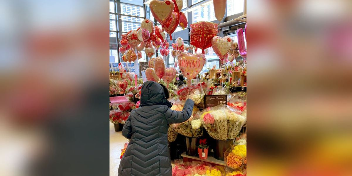 On bleak Valentine's Day, Americans find hope in roses, vaccines
