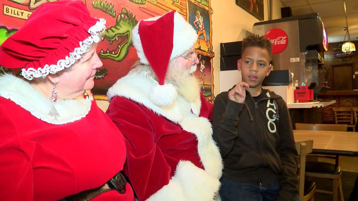 Santa learns sign language so children hard of hearing can tell him what they want for Christmas