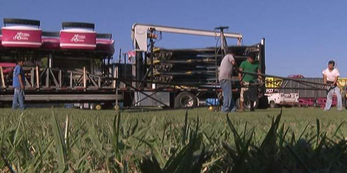 Workers set up rides for start of Greater Baton Rouge State Fair