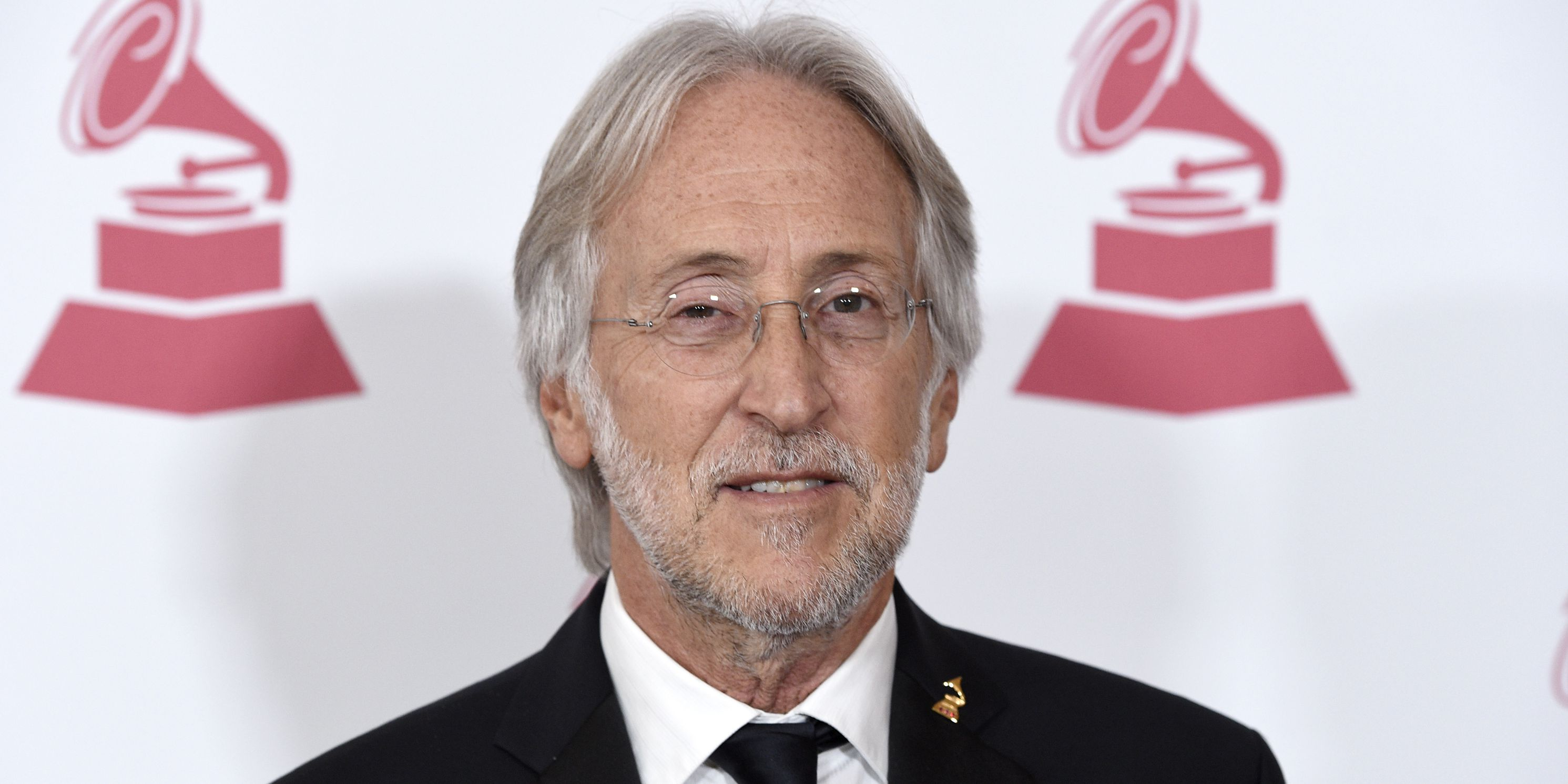 Ex-Grammys CEO says rape allegation 'false and outrageous'
