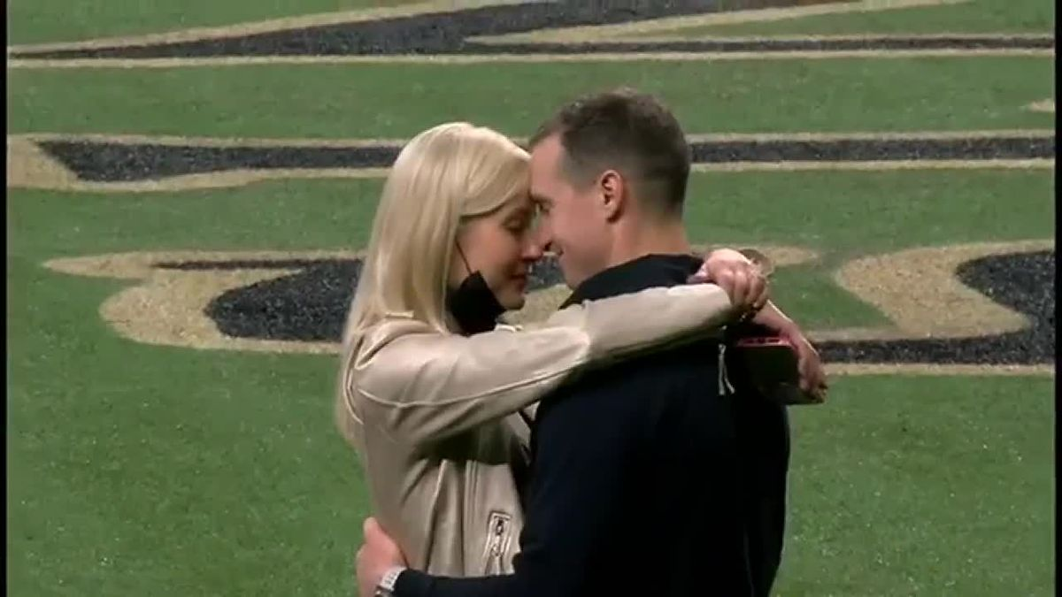 WATCH: Brees spends time after season-ending loss with family, Brady on field