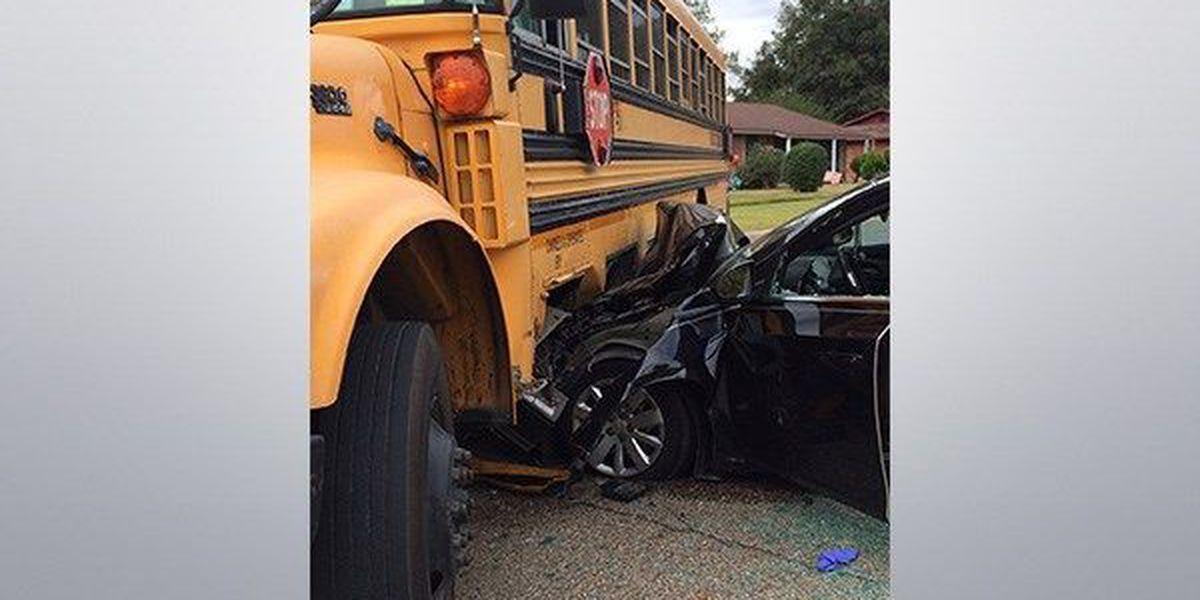 Driver hospitalized after crash involving school bus