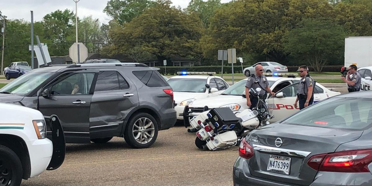 Motorcycle officer involved in wreck while leading funeral procession