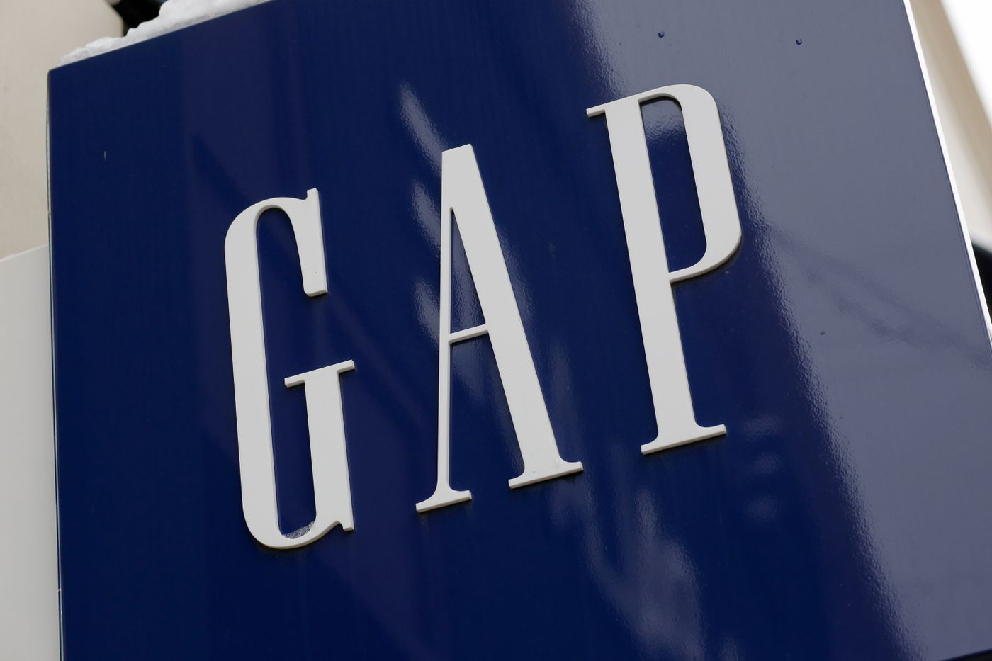 FILE - This Feb. 10, 2017 file photo shows the sign on a Gap store in the Shadyside shopping district of Pittsburgh. (AP Photo/Gene J. Puskar, File)