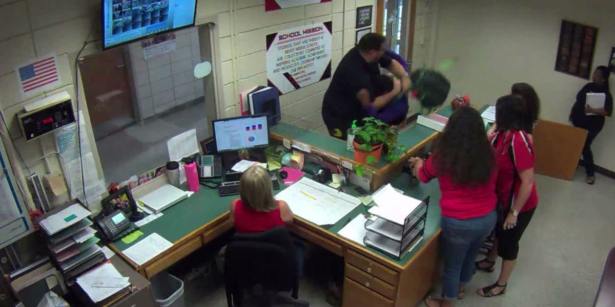 Leaked video shows violent struggle as officer says student grabbed for gun