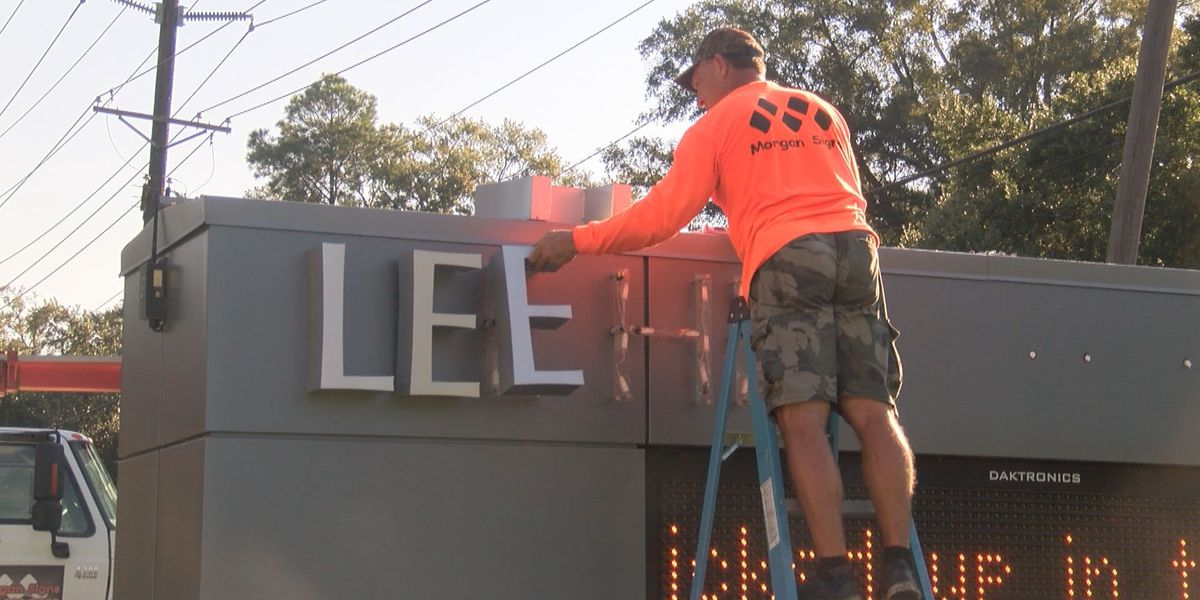 Crews remove Lee High signage from school