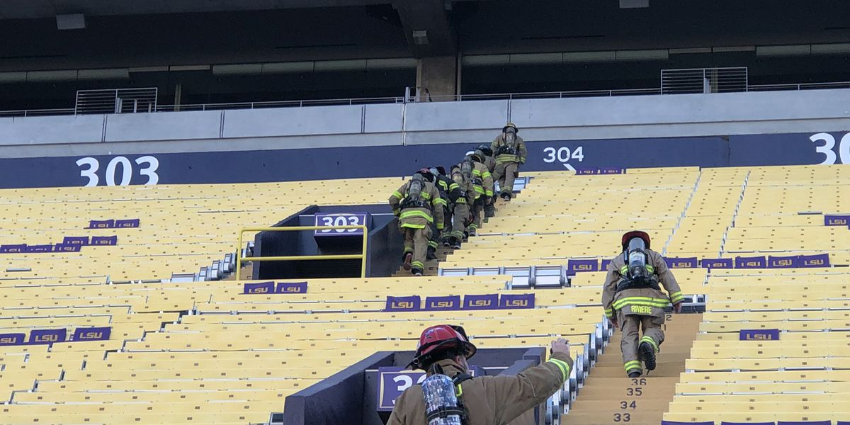Firefighters run stairs inside Tiger Stadium to remember 9/11 attacks