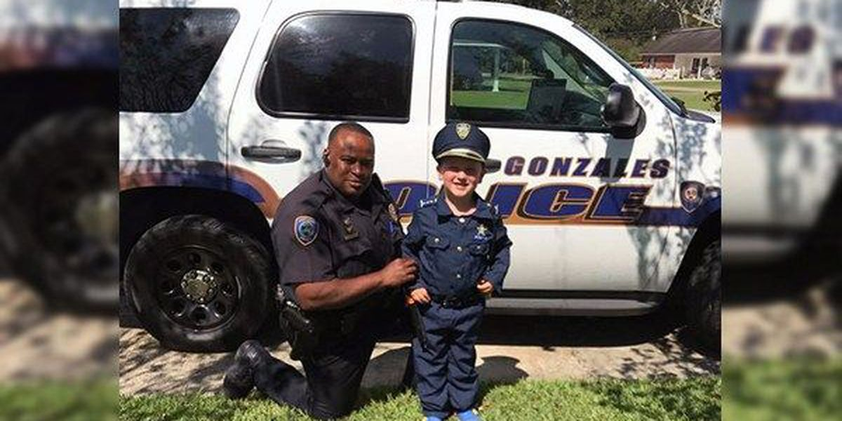 Young boy dresses up, gets to be a cop for the day
