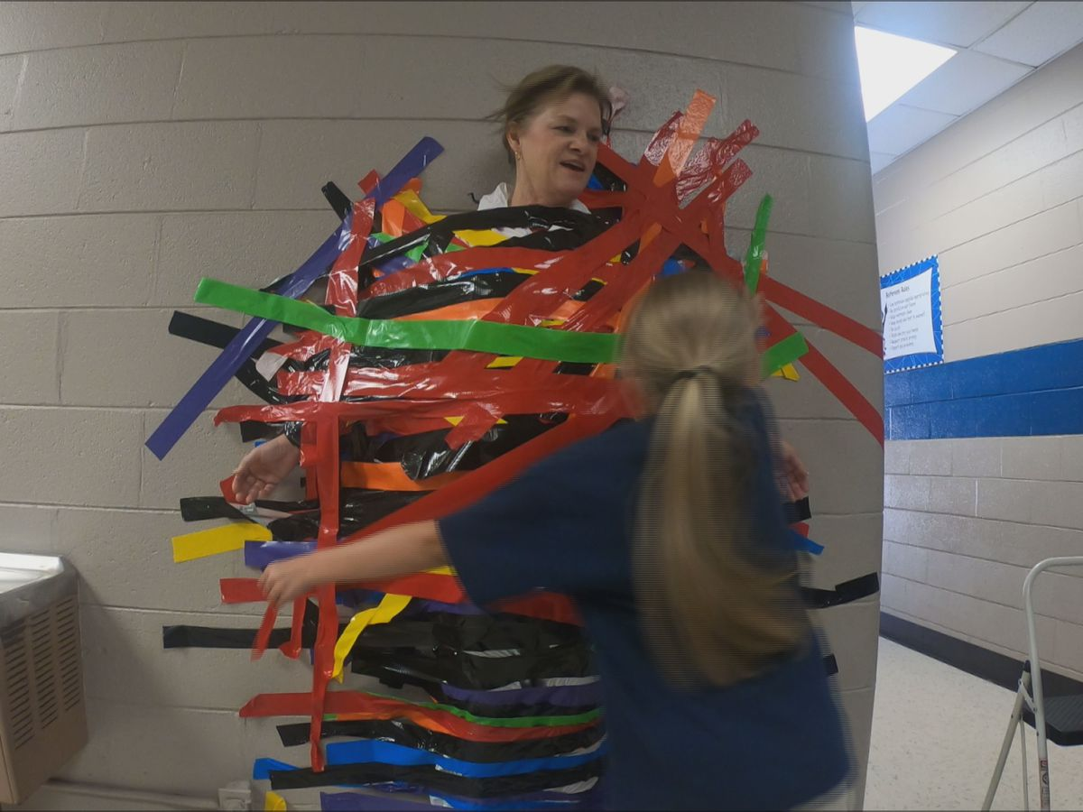 Principal loses bet to students, gets duct taped to wall