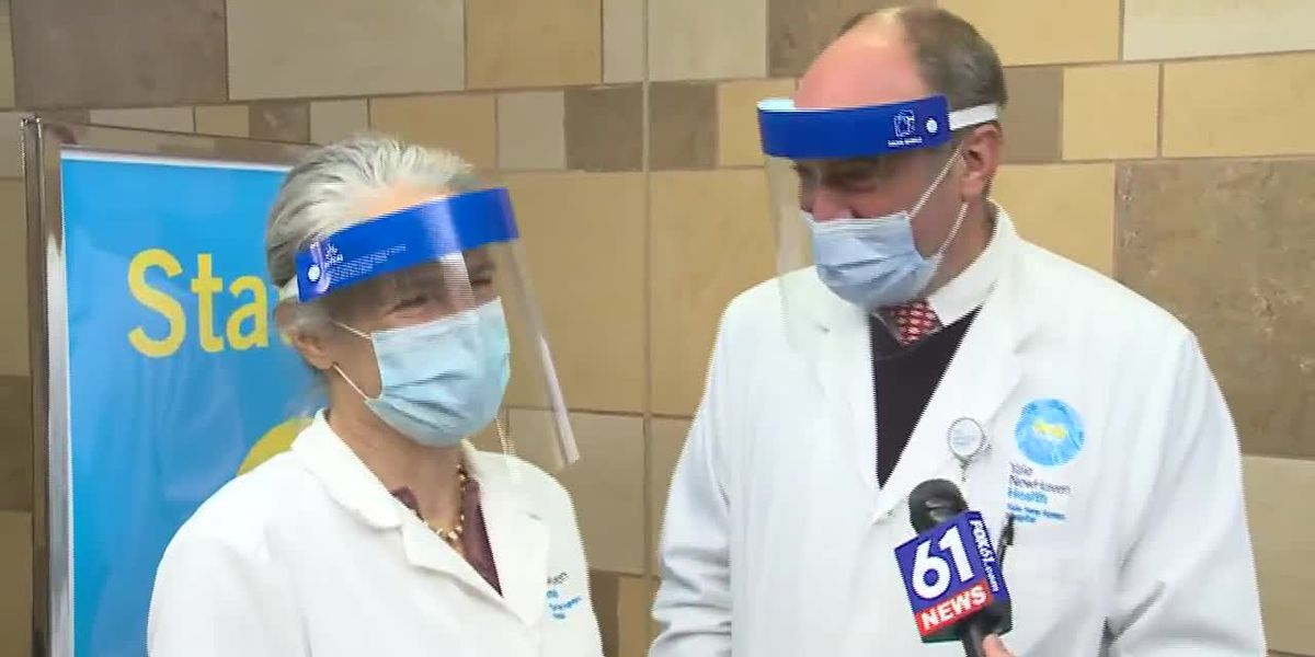 Two long-married doctors spend Valentine's Day giving people COVID-19 vaccinations