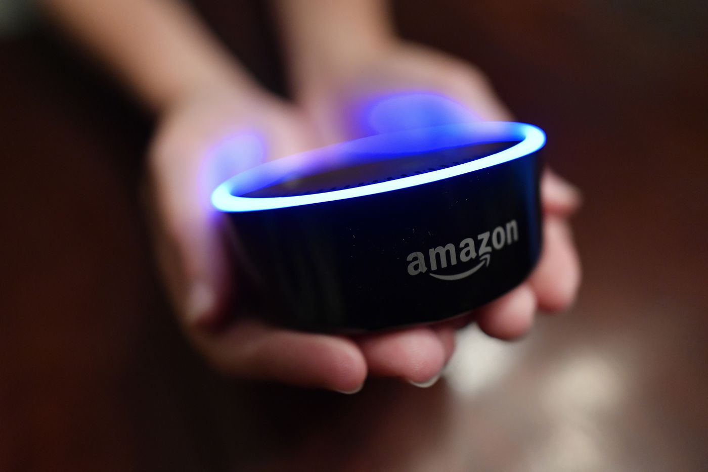 FILE - In this Aug. 16, 2018, file photo a child holds his Amazon Echo Dot in Kennesaw, Ga. (AP Photo/Mike Stewart, File)