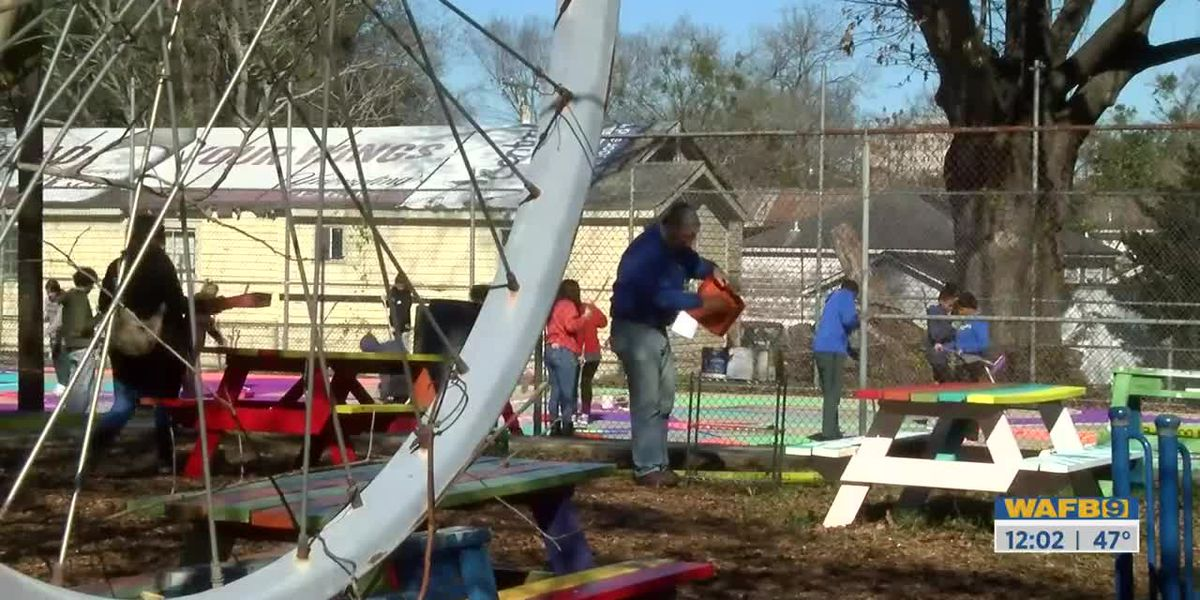 Volunteers get their hands dirty during MLK service event with Front Yard Bikes