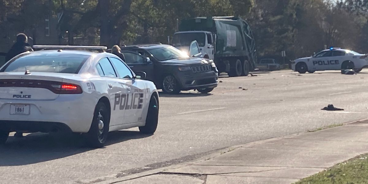 Driver cited after rear-ending garbage truck, injuring worker