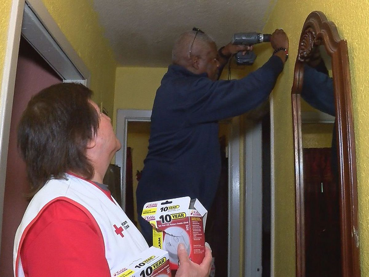 Volunteers installing free smoke alarms for homeowners
