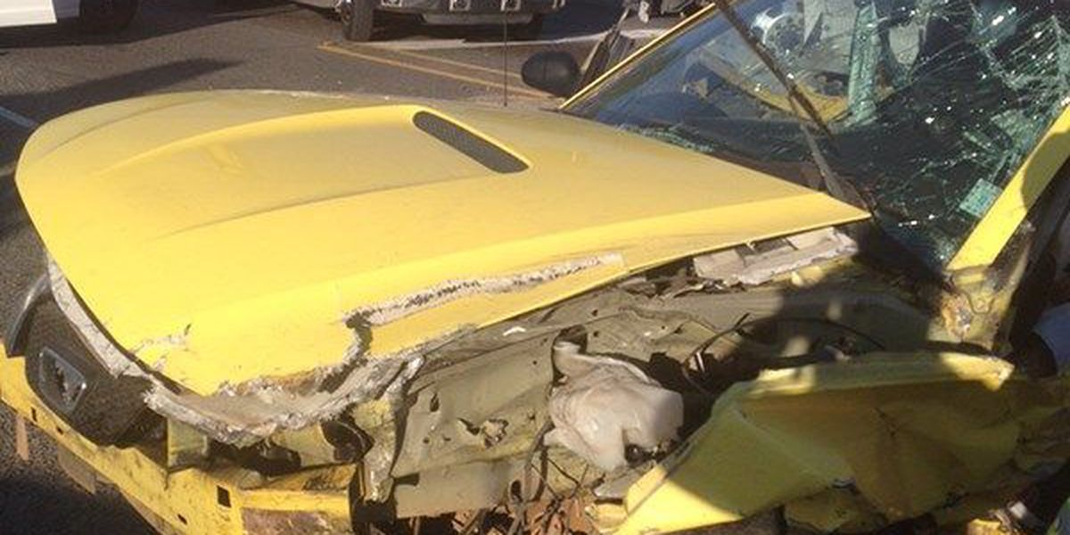 Crash involving sports car and milk truck sends 2 to the hospital