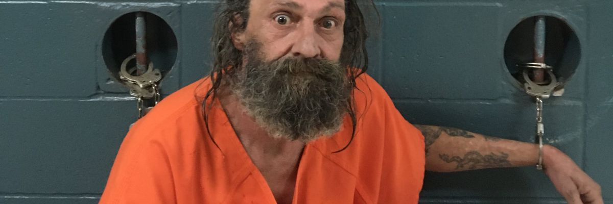 Man arrested after decomposing body found in burned trailer in Natchitoches