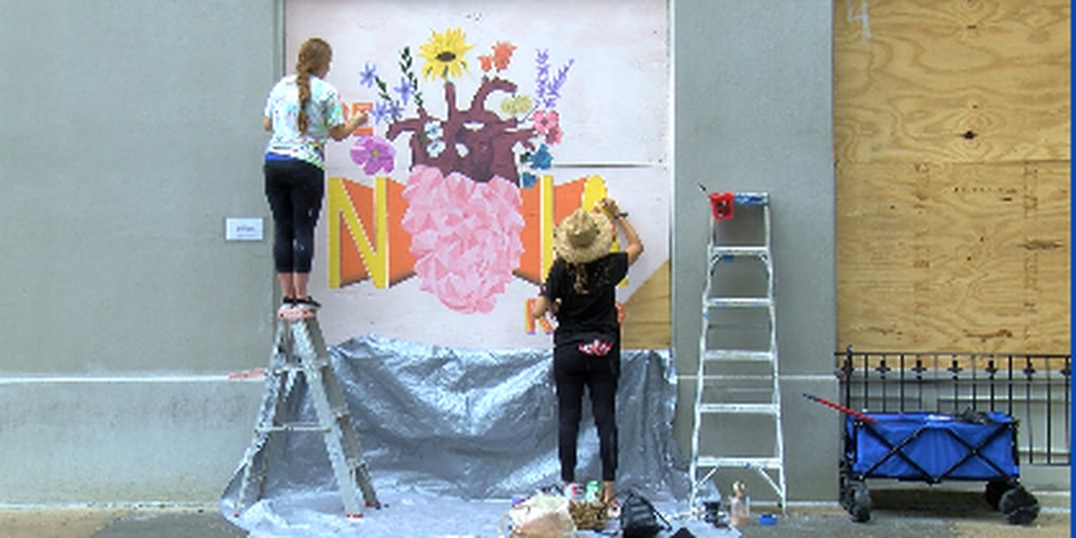 Artists brighten boarded up businesses in French Quarter