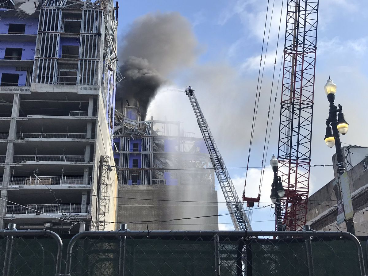 VIDEO: Crews cutting steel sparked fire at Hard Rock collapse site